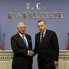 Image of Recep Tayyip Erdogan and Najib Tun Razak Handshake