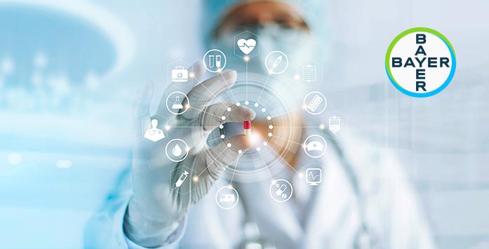Healthcare Worker Holding Medicines and Bayer Logosu