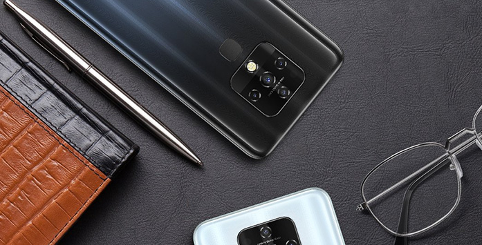 Phone, Pen and Glasses Standing on the Table