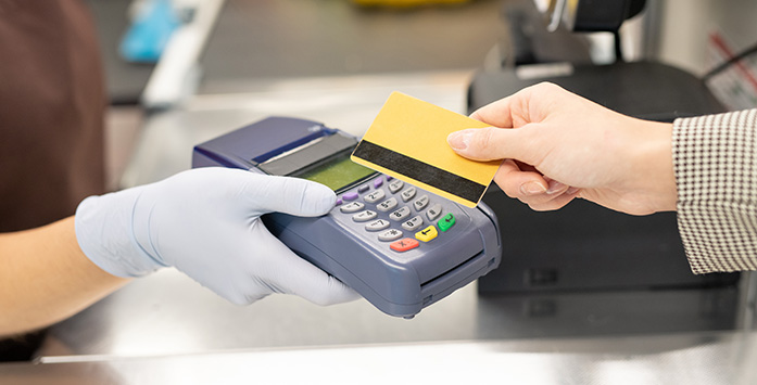 Image of Customer Paying with Credit Card