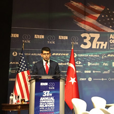 Photograph of Burak Dağlıoğlu While Giving a Speech